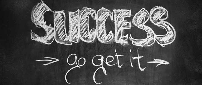 the words Success, Go Get It, written in chalk on black background